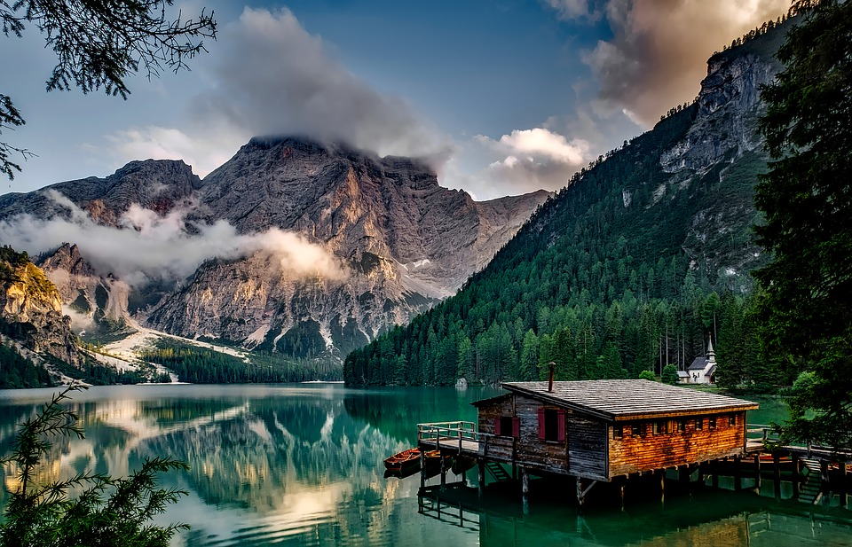 small wooden house at lake