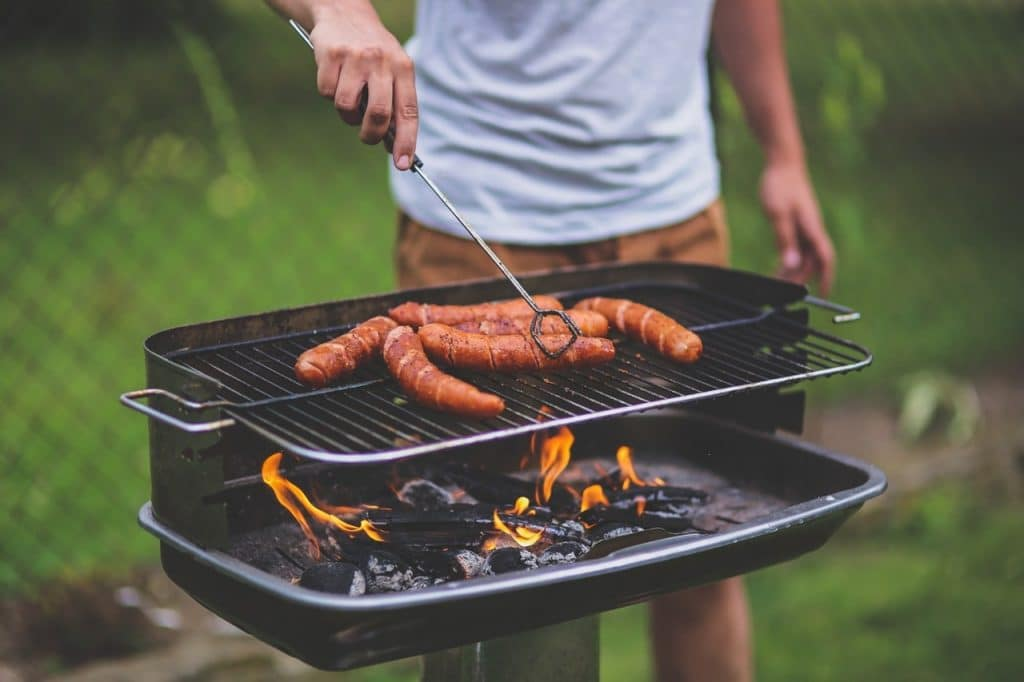 Man grilling hotdogs