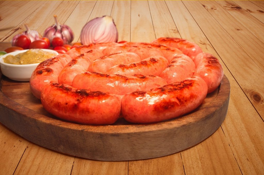 Sausages on wooden board